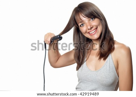 Brunette woman with black hair straightener