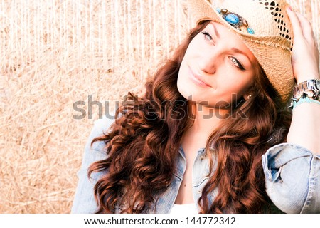 Brunette woman with cowboy hat - stock photo