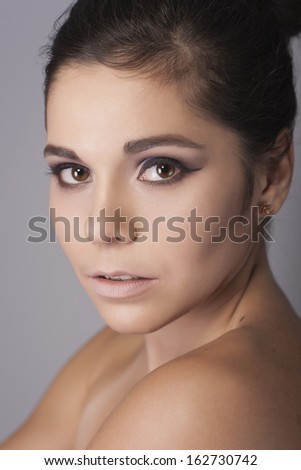 Brunette woman with neutral make up