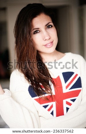 brunette woman with wet hair. heart in the colors of the British flag