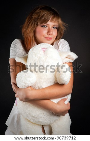 brunette young girl with plush toy - stock photo