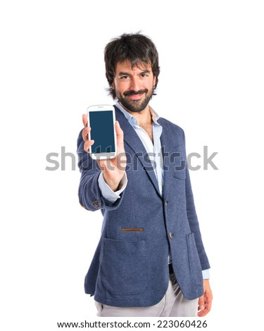 Brunetteman showing a mobile over white background - stock photo