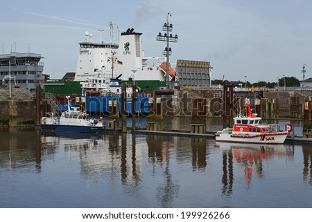 BRUNSBUETTEL, GERMANY - JUNE, 7. The freighter Sabina at the lockage Brunsbuettel (Schleswig-Holstein, Germmany) to the Kiel Canal as entering the newly repaired lock chamber on June 7, 2014.