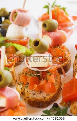 Bruschetta bread with prosciutto, olive, cheese and tomato