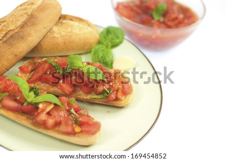 Bruschetta on a plate on a white background