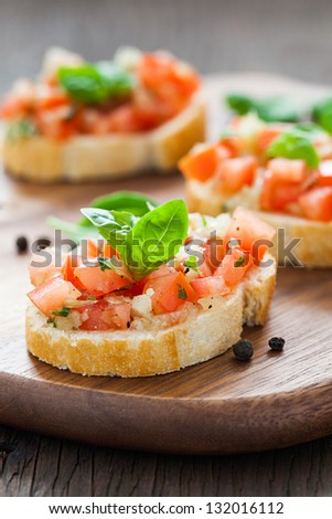 bruschetta on wooden board with pepper - stock photo