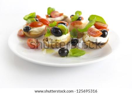 bruschetta over white plate - stock photo