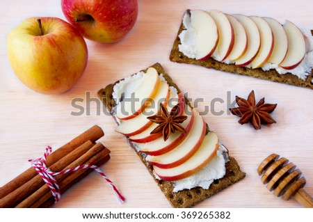 Bruschetta with cream cheese, apples and honey - stock photo