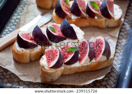 Bruschetta with figs and goat cheese - stock photo