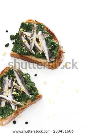 Bruschetta with fish - stock photo