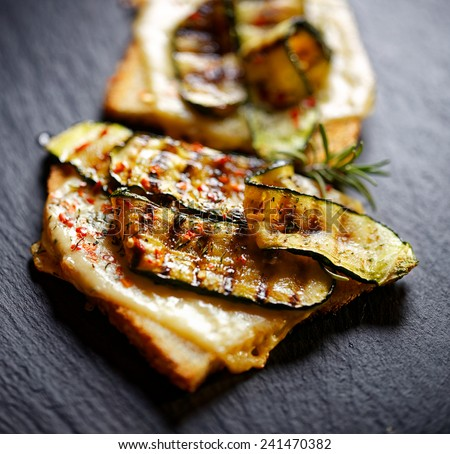 Bruschetta with grilled zucchini and cheese - stock photo
