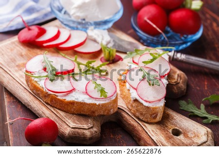 Bruschetta with radishes, feta cheese and arugula.selective focus - stock photo