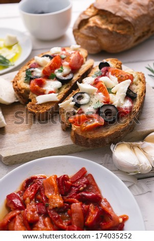 Bruschetta with tomatoes, pepper, mozzarella and garlic - stock photo