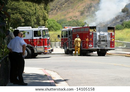 Brush fire in Ventura, California. The fire consumed 25 acres and was quickly controlled by more then 100 firefighters and water dropping helicopters. - stock photo
