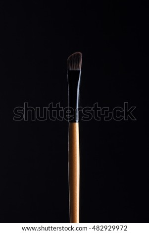 brush for make-up isolated on black background