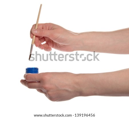 Brush of the artist in blue paint with the flasks, isolated on white - stock photo