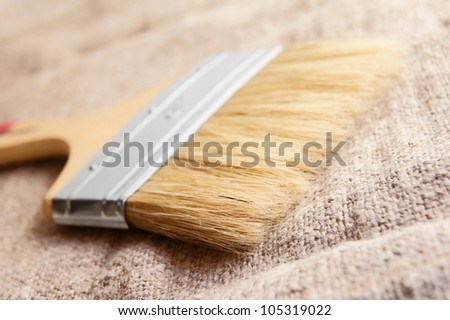 Brush on a fabric. On a white background. - stock photo