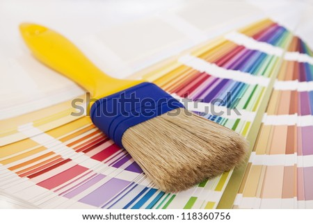 brush on top of color card schemes for paint decorating - stock photo