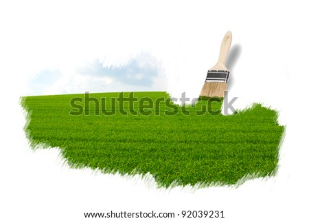 brush painting a green field - stock photo