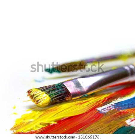 Brush strokes and brush on light background - stock photo