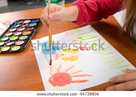 Brush the child draws a picture paints
