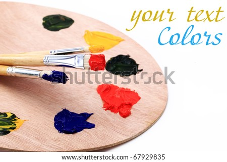 Brush to the palette on a white background