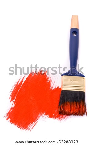 Brush with red paint on the white background
