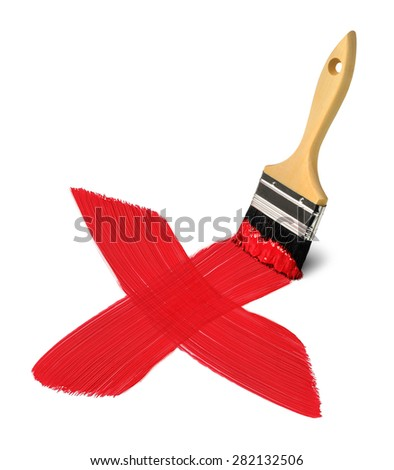 Brush with red painting strokes crossing forming big X - stock photo