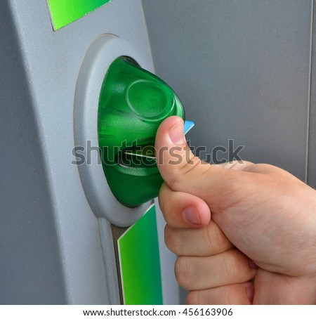 Brush your hands, puts credit card into the ATM.