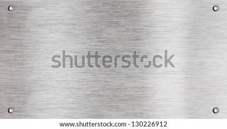 Brushed aluminum metal plate with screw - stock photo