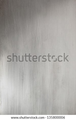 Brushed metal plate in surface - stock photo