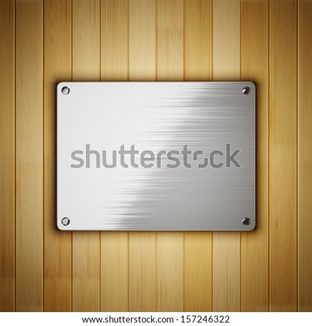 Brushed metal plate on wooden wall