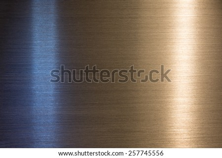 Brushed metal with blue cool light and orange warm light reflection.   - stock photo