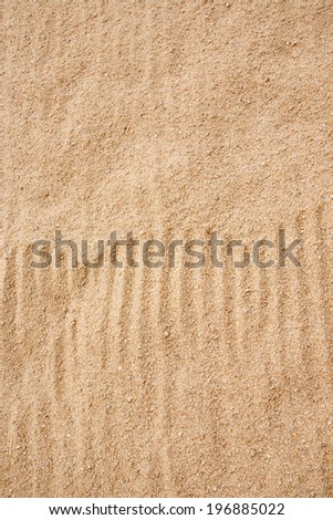 Brushed sand texture - stock photo