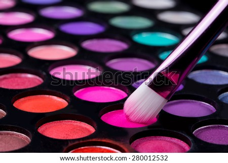 brushes and make-up eye shadows - stock photo