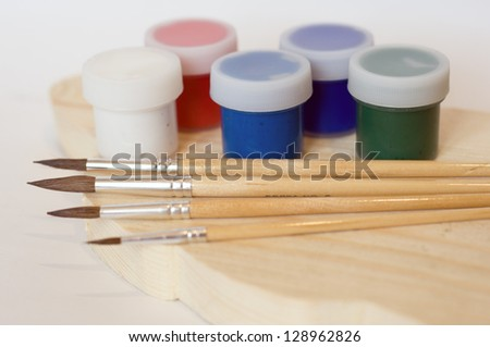 Brushes and paints.