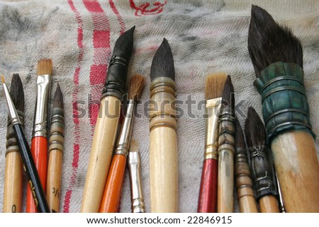 Brushes for drawing on a table - stock photo