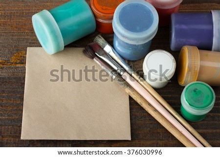 brushes for drawing with ink on paper on wooden table closeup