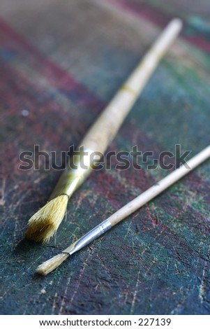 Brushes on a colorfull table - stock photo