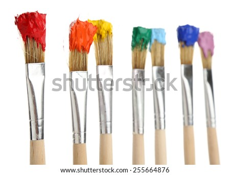 Brushes with colorful paints, isolated on white - stock photo