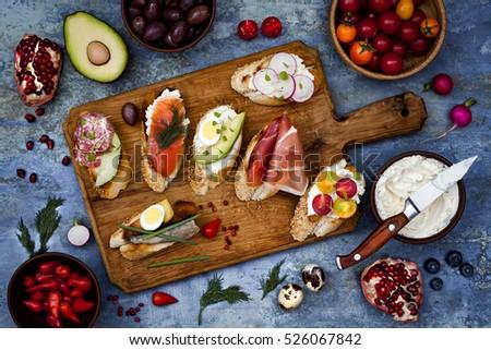 Brushetta or authentic traditional spanish tapas set for lunch table. Sharing antipasti on party or & Brushetta Authentic Traditional Spanish Tapas Set Stock Photo ...