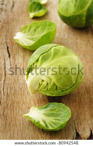 brussel sprouts on wood - stock photo