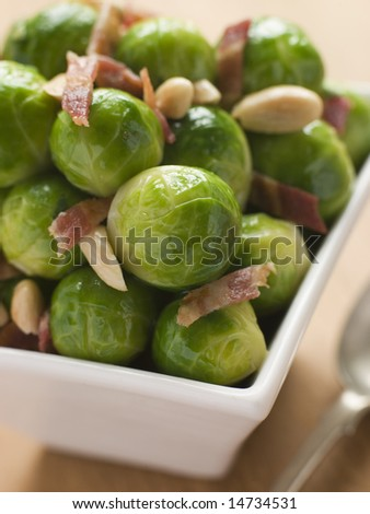 Brussel Sprouts with Fried Bacon and Almonds - stock photo