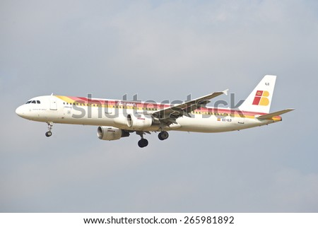BRUSSELS - APRIL 2: Airbus A321-200 of Iberia approaching Brussels Airport in Brussels, BELGIUM on APRIL 2, 2015. Iberia is the flag carrier and the largest airline of Spain. - stock photo
