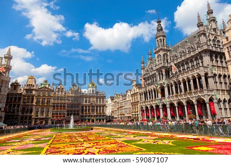 BRUSSELS - AUGUST 14: Every two years thousands of visitors come to see the floral carpet on the famous Grand Place square on August 14, 2010 in Brussels.  Almost 800,000 begonias were  used this year. - stock photo