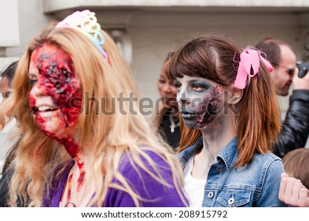 BRUSSELS, BELGIUM-APRIL 12: unknown participants at ZomBIFFF Parade (Zombie Parade) 2014 on April 12, 2014 in Brussels. The Zombie Parade was part of Brussels International Fantastic Film Festival.  - stock photo