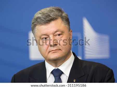 BRUSSELS, BELGIUM - Aug 27, 2015: President of Ukraine Petro Poroshenko during a joint press conference with European Commission President Jean-Claude Juncker in Brussels - stock photo
