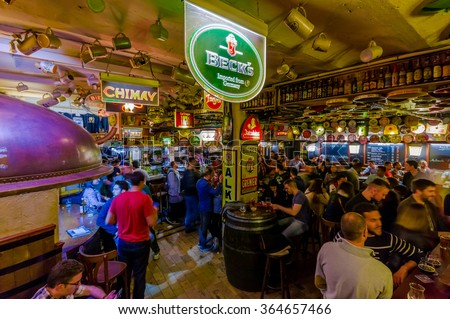BRUSSELS, BELGIUM - 11 AUGUST, 2015: Famous Delirium Bar inside overview crowded room of people enjoying their beers - stock photo