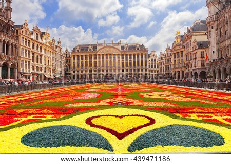 BRUSSELS, BELGIUM - AUGUST 15, 2014: Famous Grand Place during Flower Carpet Festival. Giant Turkish floral carpet within the celebrations of the 50th anniversary of Turkish workers' migration - stock photo