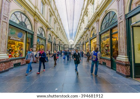 BRUSSELS, BELGIUM - 11 AUGUST, 2015: Galerie Royales Saint Hubert, very nice view down shopping alley showing spectacular glass roof construction and several shops along both sides. - stock photo